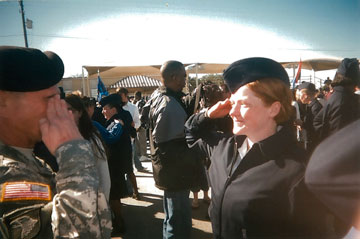 An image from The Invisible War showing a male and female soldier saluting