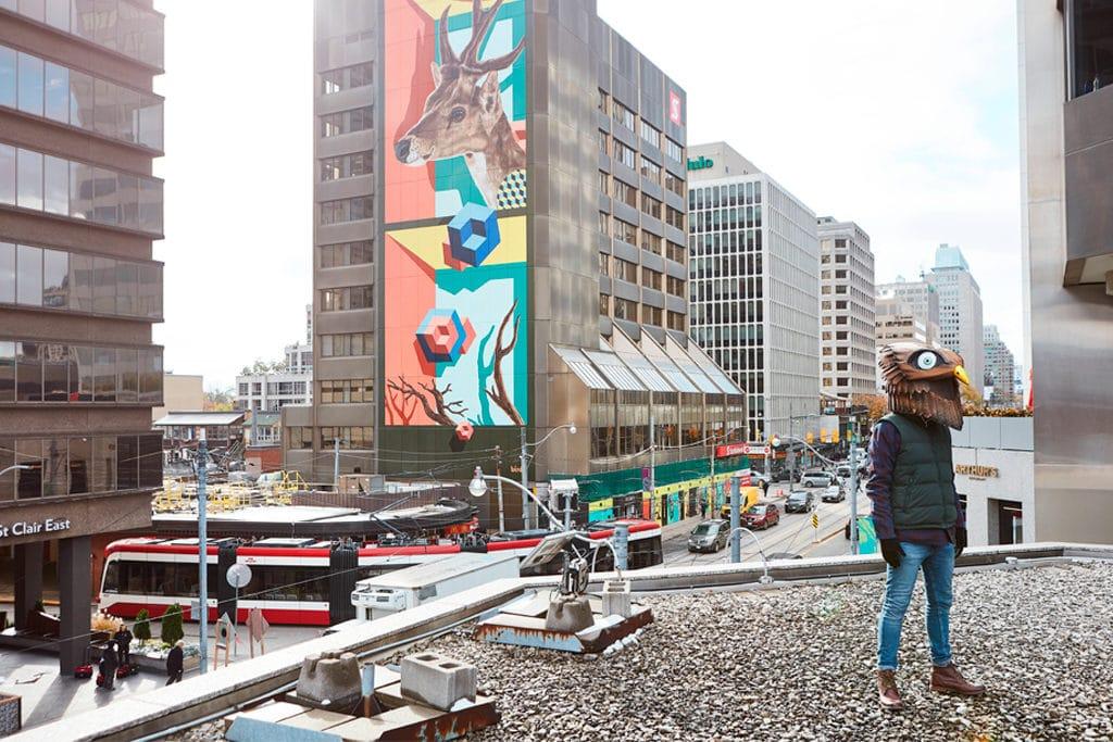 Artist birdO with new mural