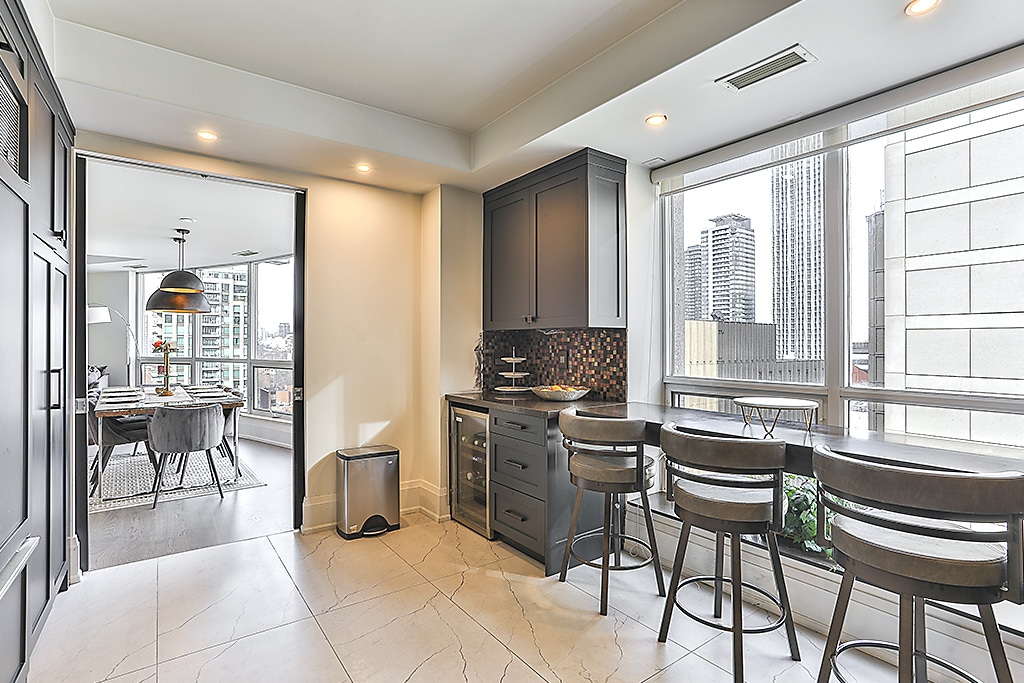 The breakfast bar at the windows give homeowners a nice spot to check out the city views below.