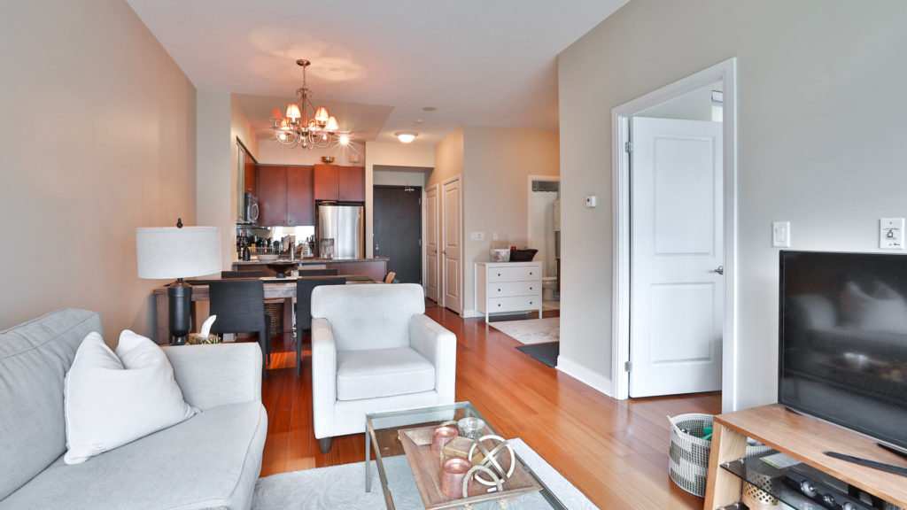 A photo of the living and dining space of the condo.
